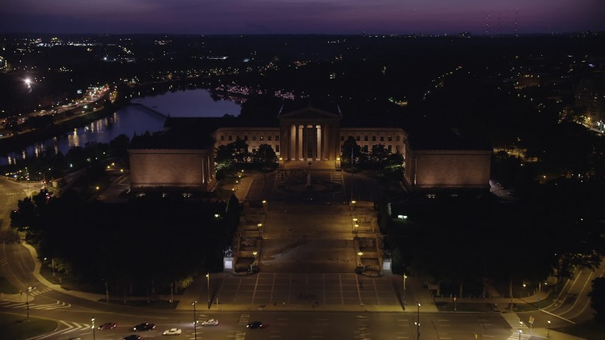 5K stock footage aerial video flying over Philadelphia Museum of Art to approach Boathouse Row, Pennsylvania, Night Aerial Stock Footage AX81_024 | Axiom Images