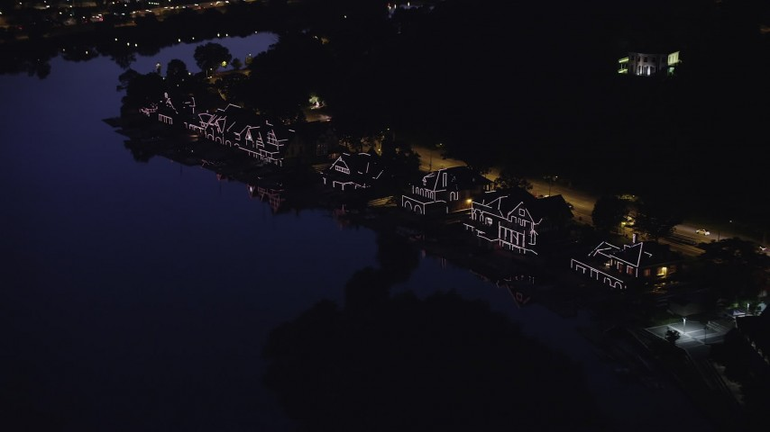 5K stock footage aerial video of Boathouse Row lit up at night, Philadelphia, Pennsylvania Aerial Stock Footage | AX81_025
