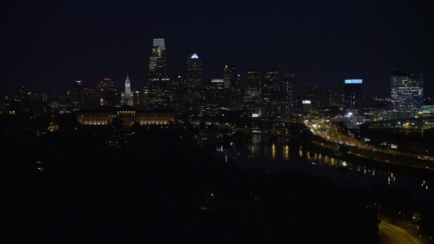5K aerial video of Downtown Philadelphia skyline behind the Philadelphia Museum of Art and the Schuylkill River, Pennsylvania, Night Aerial Stock Footage AX81_028