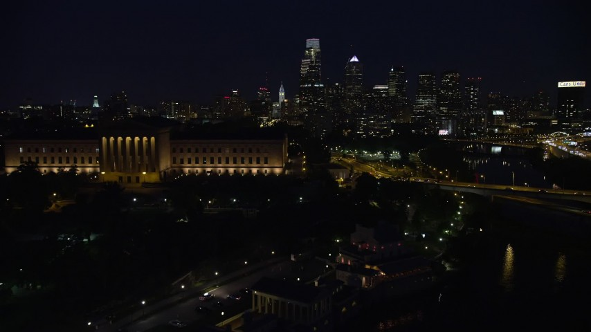 5K stock footage aerial video flying by Philadelphia Museum of Art and approach Downtown Philadelphia skyline, Pennsylvania, Night Aerial Stock Footage AX81_030 | Axiom Images