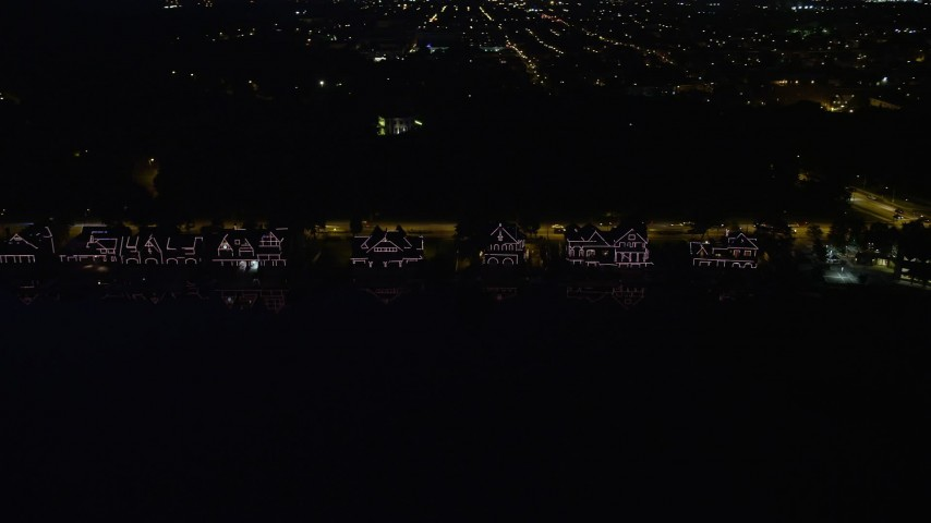 5K stock footage aerial video of Boathouse Row by the Schuylkill River at night in Philadelphia, Pennsylvania Aerial Stock Footage | AX81_033