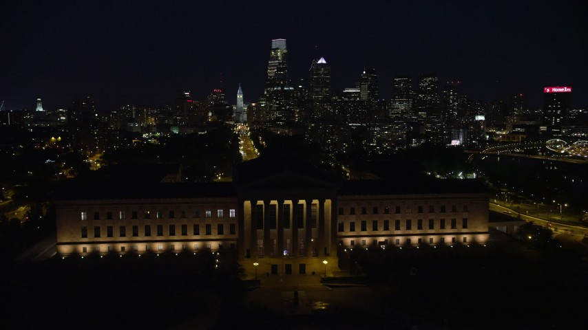 5K stock footage aerial video approach and fly over Philadelphia Museum of Art, Downtown Philadelphia skyline in the background, Pennsylvania, Night Aerial Stock Footage   AX81_034E