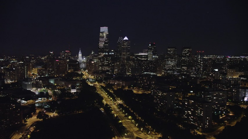 5K stock footage aerial video following Benjamin Franklin Parkway toward City Hall and Downtown Philadelphia skyline, Pennsylvania, Night Aerial Stock Footage | AX81_036