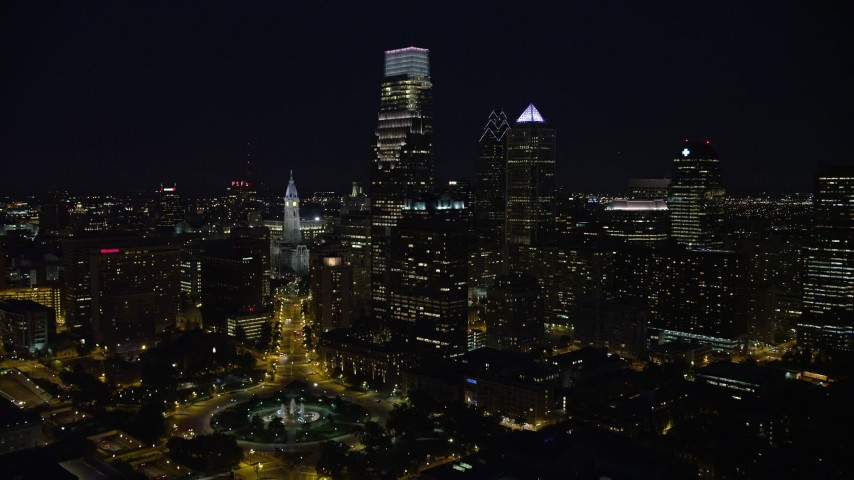 5K stock footage aerial video following Benjamin Franklin Parkway toward City Hall and Downtown Philadelphia skyline, Pennsylvania, Night Aerial Stock Footage | AX81_036E
