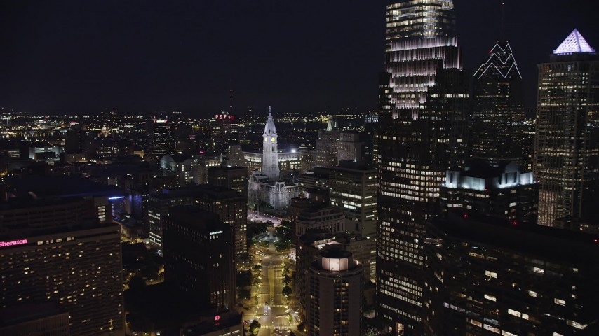 5K stock footage aerial video approaching Philadelphia City Hall in Downtown Philadelphia, Pennsylvania, Night Aerial Stock Footage | AX81_038