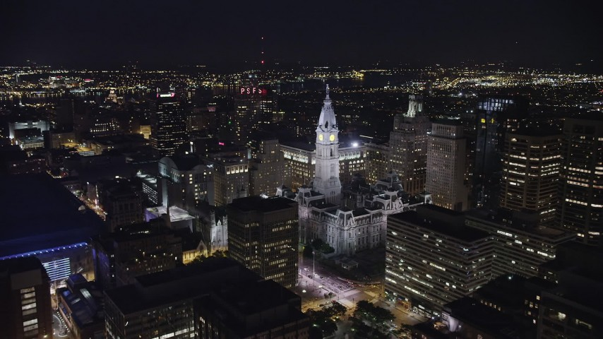 5K aerial video of the Masonic Temple and Philadelphia City Hall, Downtown Philadelphia, Pennsylvania, Night Aerial Stock Footage | AX81_039