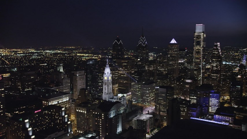 5K stock footage aerial video of a reverse view of Downtown Philadelphia skyscrapers and City Hall, Pennsylvania, Night Aerial Stock Footage | AX81_041