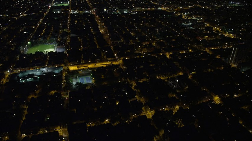 5K stock footage aerial video of urban neighborhoods and baseball fields in South Philadelphia, Pennsylvania, Night Aerial Stock Footage | AX81_043