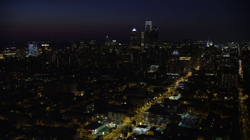 5K stock footage aerial video of Downtown Philadelphia skyline and Broad Street leading to City Hall, Pennsylvania, Night Aerial Stock Footage | AX81_045