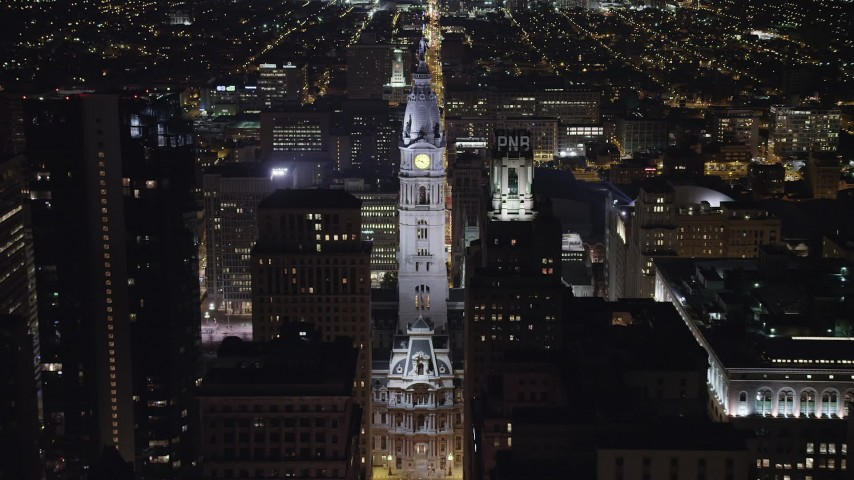 5K stock footage aerial video approaching Philadelphia City Hall, Pennsylvania Night Aerial Stock Footage | AX81_047