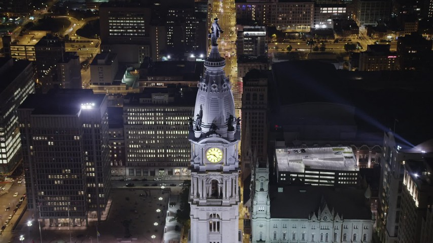 5K stock footage aerial video tilting to bird's eye of William Penn statue atop the Philadelphia City Hall, Pennsylvania, Night Aerial Stock Footage AX81_048 | Axiom Images