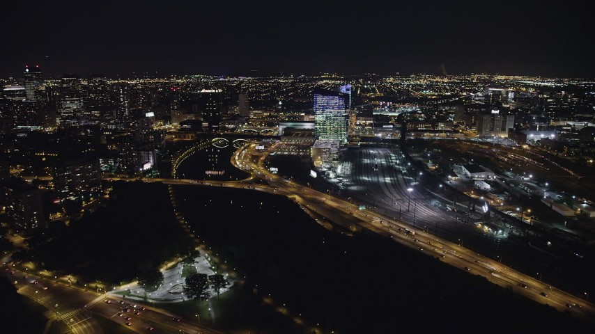 5K stock footage aerial video of bridges over the Schuylkill River by Cira Centre, I-76 and train yard, West Philadelphia, Pennsylvania, Night Aerial Stock Footage | AX81_050