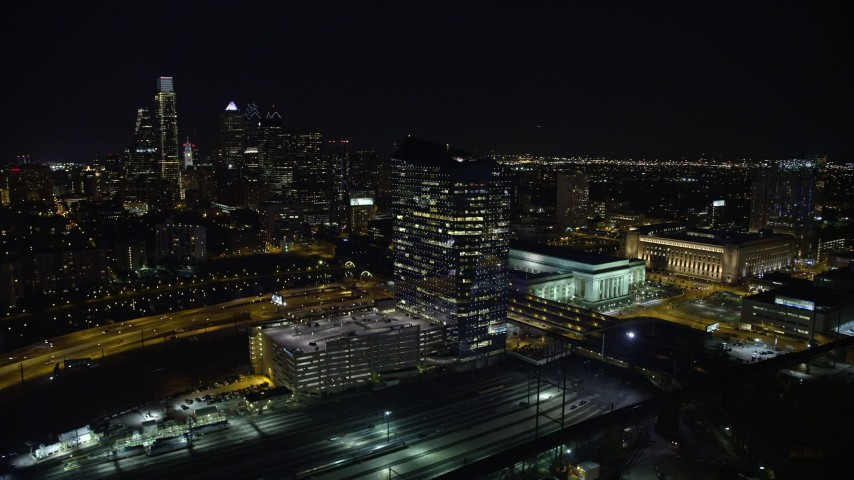 5K stock footage aerial video of orbit bridges over the Schuylkill River by Cira Centre, I-76 and train yard, reveal Downtown Philadelphia, Pennsylvania, Night Aerial Stock Footage   AX81_050E