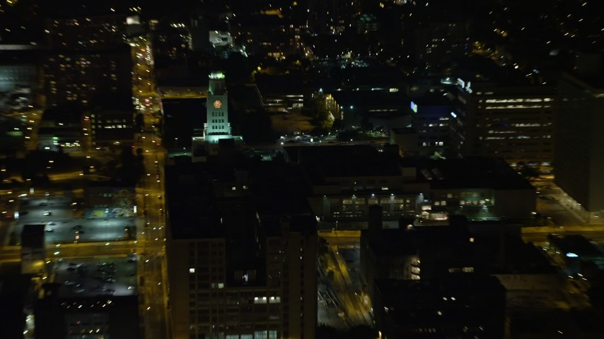 5K aerial video of the Inquirer Building clock tower in Downtown Philadelphia , Pennsylvania, Night Aerial Stock Footage | AX81_057