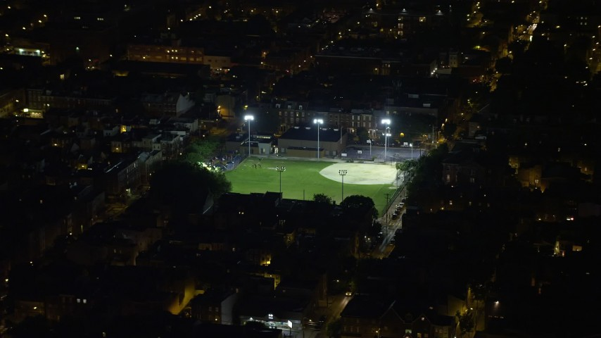 5K aerial video of baseball field in an urban neighborhood in South Philadelphia, Pennsylvania, Night Aerial Stock Footage | AX81_060