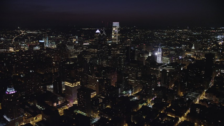 5K aerial video approaching Two Liberty Place and Comcast Center, Downtown Philadelphia, Pennsylvania, Night Aerial Stock Footage | AX81_063