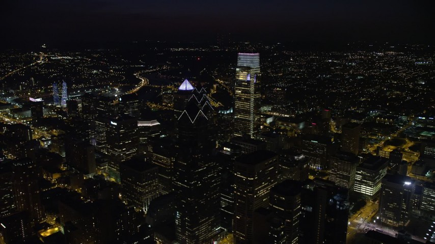 5K stock footage aerial video flying over Downtown Philadelphia's tall skyscrapers to reveal Philadelphia Museum of Art, Pennsylvania, Night Aerial Stock Footage | AX81_064