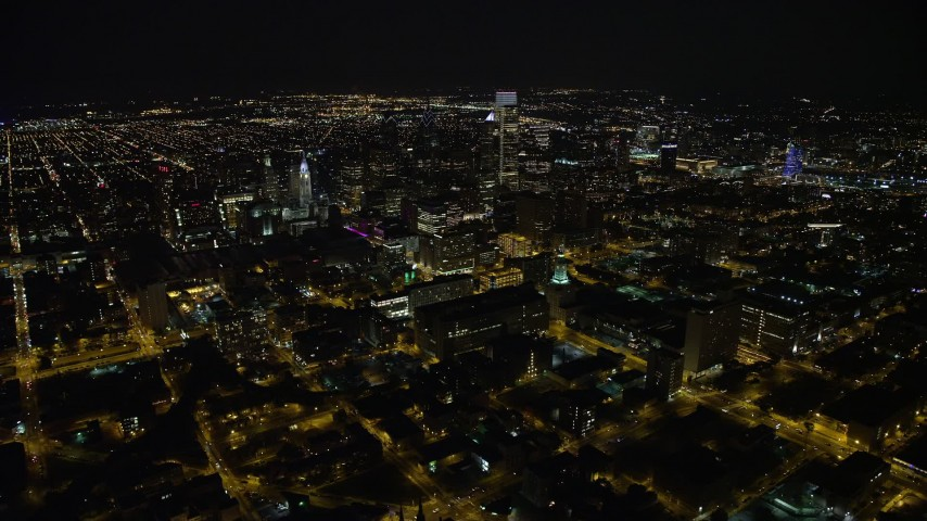 5K stock footage aerial video orbit and approach Downtown Philadelphia skyscrapers at night in Pennsylvania Aerial Stock Footage | AX81_066E