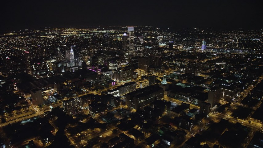 5K stock footage aerial video flying over I-676 to approach Downtown Philadelphia skyscrapers and city hall, Pennsylvania, Night Aerial Stock Footage | AX81_067