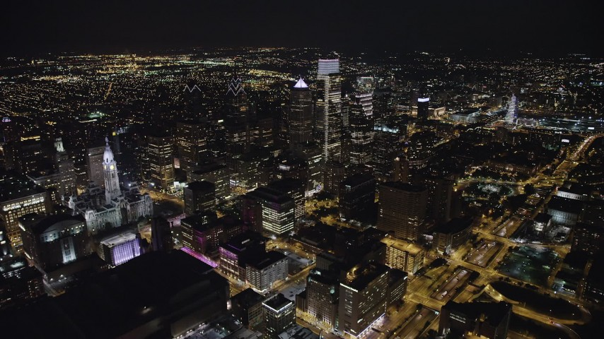 5K stock footage aerial video flying by City Hall and over Downtown Philadelphia's skyscrapers, Pennsylvania, Night Aerial Stock Footage | AX81_068