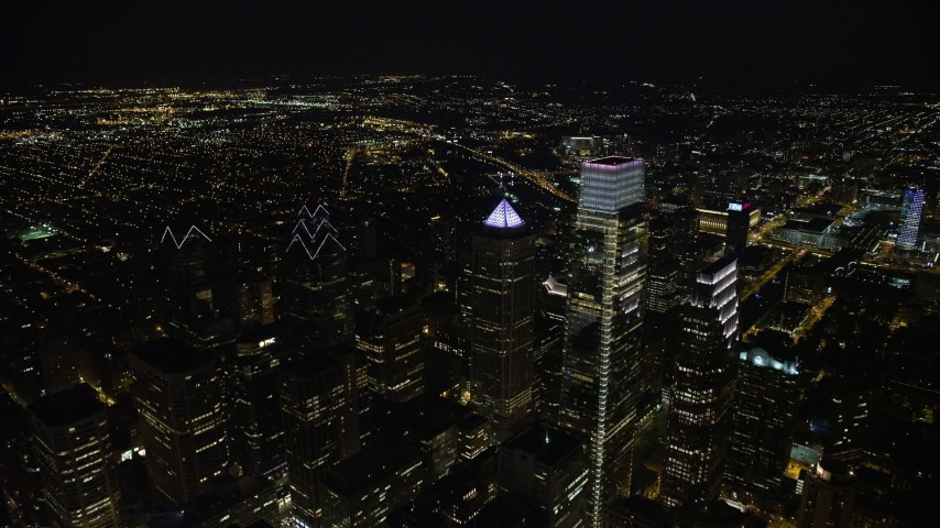 5K stock footage aerial video flying by City Hall and over Downtown Philadelphia's skyscrapers, Pennsylvania, Night Aerial Stock Footage   AX81_068E