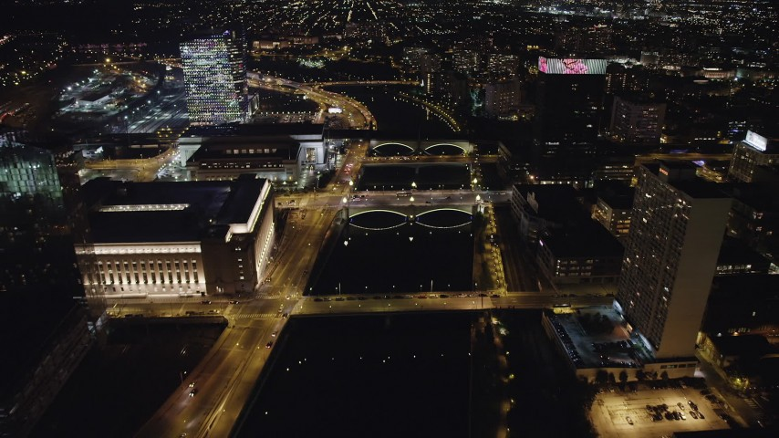 5K stock footage aerial video of small bridges spanning Schuylkill River by office buildings, Philadelphia, Pennsylvania Night Aerial Stock Footage | AX81_071