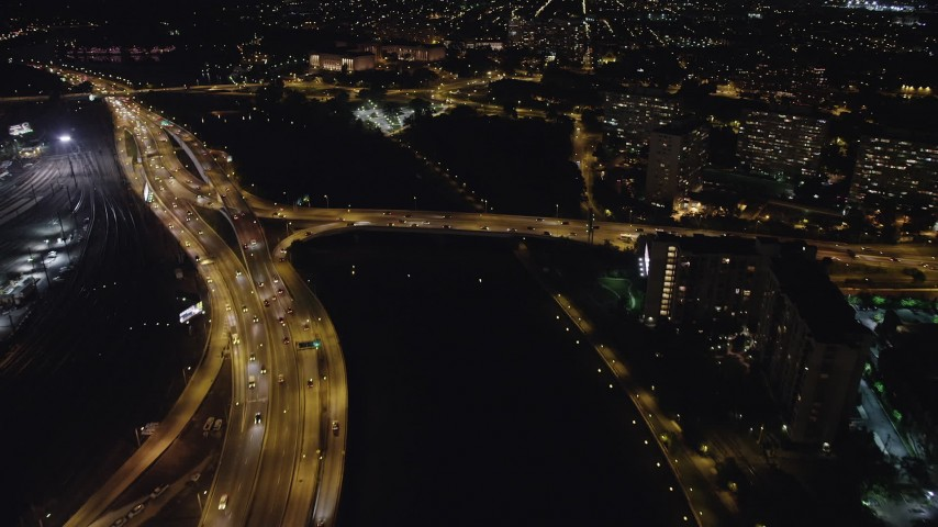 5K stock footage aerial video following Schuylkill River to approach Philadelphia Museum of Art, Pennsylvania, Night Aerial Stock Footage | AX81_072