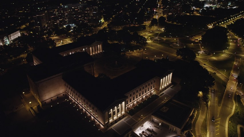 5K aerial video orbiting Philadelphia Museum of Art, tilt up to reveal Downtown Philadelphia skyline, Pennsylvania, Night Aerial Stock Footage | AX81_074