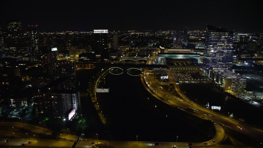 5K stock footage aerial video flying over small bridges spanning Schuylkill River in Philadelphia, Pennsylvania, Night Aerial Stock Footage | AX81_075