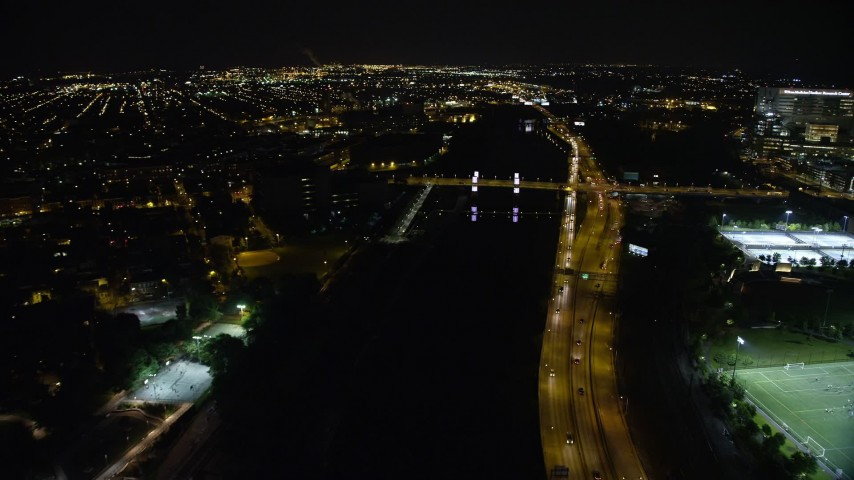 5K stock footage aerial video approaching and tilting to South Street Bridge over the Schuylkill River, Philadelphia, Pennsylvania, Night Aerial Stock Footage | AX81_077