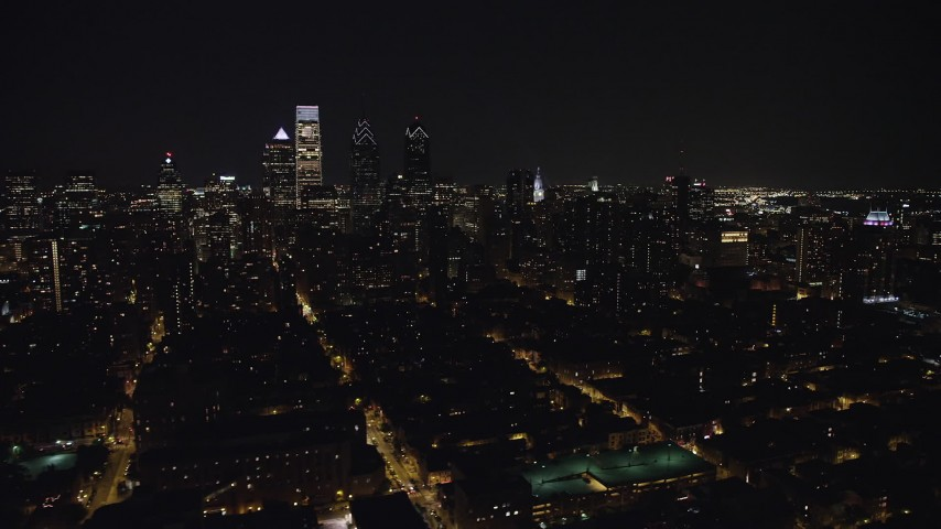 5K aerial video flying by Downtown Philadelphia skyscrapers and Broad Street leading to City Hall, Pennsylvania, Night Aerial Stock Footage | AX81_080