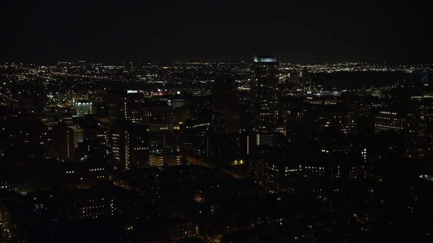 5K stock footage aerial video flying by Downtown Philadelphia apartment and office buildings, Pennsylvania, Night Aerial Stock Footage | AX81_081