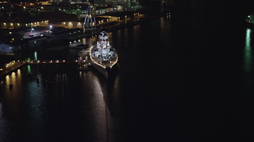 5K stock footage aerial video approaching the USS New Jersey in Camden, New Jersey, Night Aerial Stock Footage | AX81_083