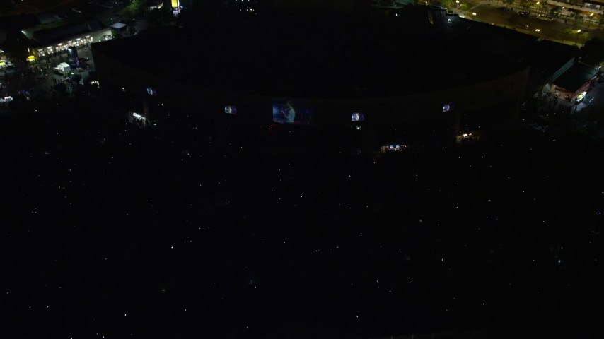 5K aerial video tilting to a bird's eye view of a music concert at BB&T Pavilion, Camden, New Jersey Night Aerial Stock Footage | AX81_087