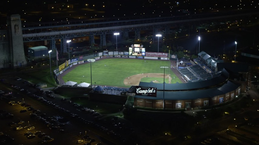 5K stock footage aerial video of a baseball game at Campbell's Field in Camden, New Jersey, Night Aerial Stock Footage | AX81_089