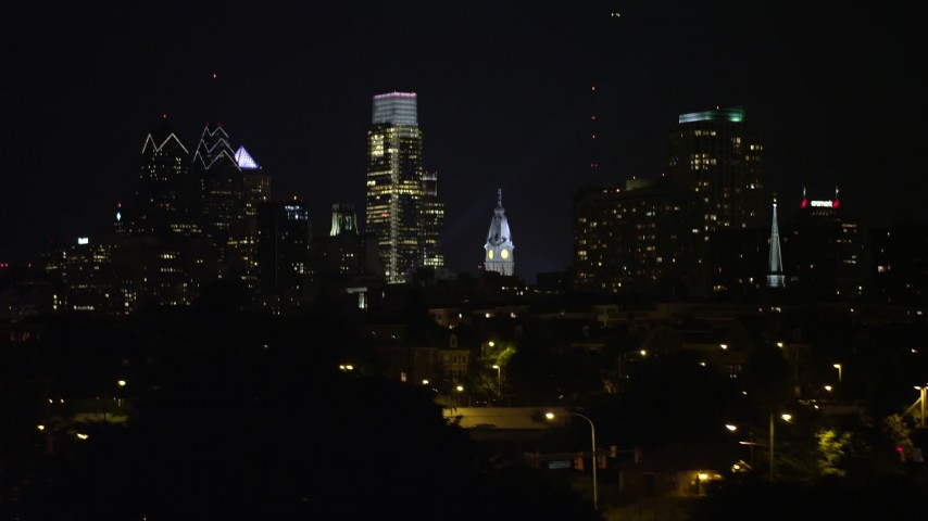5K stock footage aerial video of Downtown Philadelphia skyline seen from Delaware River, Pennsylvania, Night Aerial Stock Footage | AX81_094
