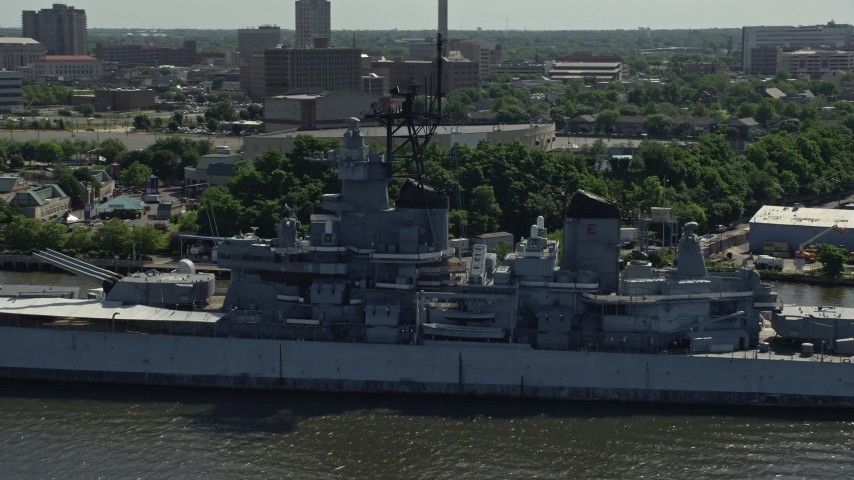5K stock footage aerial video flying by the battleship USS New Jersey, Camden, New Jersey Aerial Stock Footage | AX82_001