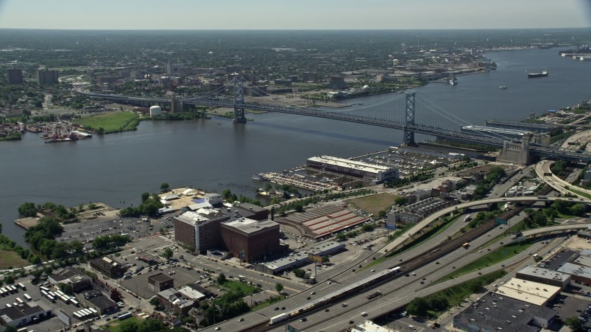 5K stock footage aerial video of Benjamin Franklin Bridge and Delaware River, Philadelphia, Pennsylvania Aerial Stock Footage | AX82_006