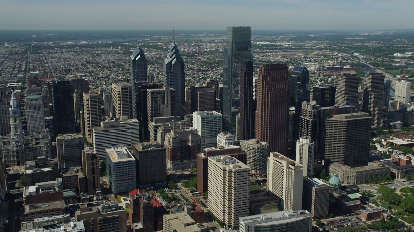 5K aerial video flying by Downtown Philadelphia skyscrapers, Pennsylvania Aerial Stock Footage | AX82_009