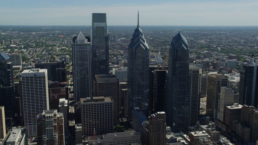 5K stock footage aerial video flying by Downtown Philadelphia's giant skyscrapers, Pennsylvania Aerial Stock Footage | AX82_013