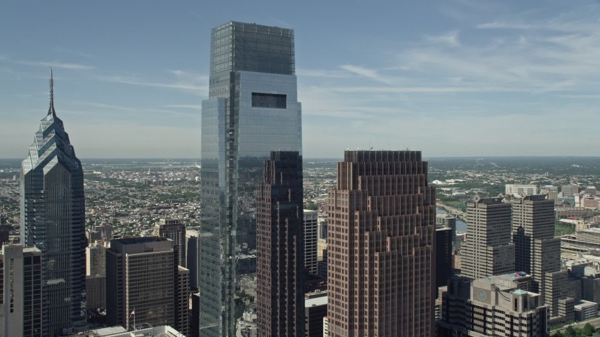 5K stock footage aerial video of Comcast Center and Three Logan Square in Downtown Philadelphia, Pennsylvania Aerial Stock Footage AX82_017