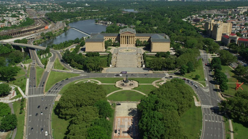 5K stock footage aerial video flying over Washington Monument Fountain to approach Philadelphia Museum of Art, Pennsylvania Aerial Stock Footage | AX82_019