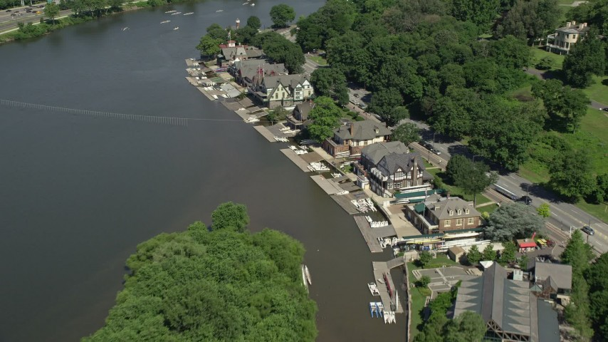 5K stock footage aerial video flying over Boathouse Row by the Schuylkill River, Philadelphia, Pennsylvania Aerial Stock Footage | AX82_020