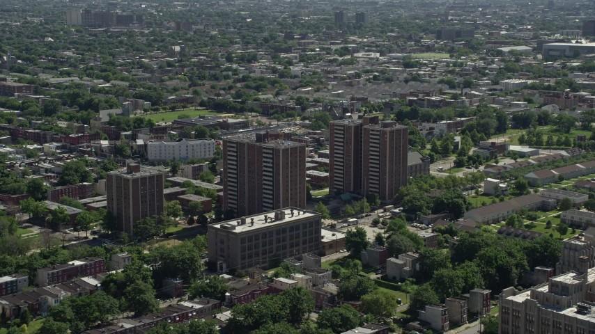 5K stock footage aerial video of apartment buildings in an urban neighborhood, North Philadelphia, Pennsylvania Aerial Stock Footage | AX82_022