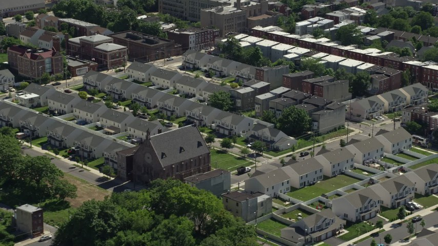 5K stock footage aerial video of urban neighborhood with town houses, North Philadelphia, Pennsylvania Aerial Stock Footage | AX82_023