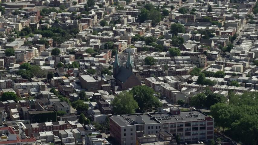 5K stock footage aerial video of St. Laurentius Parish church in an urban neighborhood, North Philadelphia, Pennsylvania Aerial Stock Footage | AX82_026
