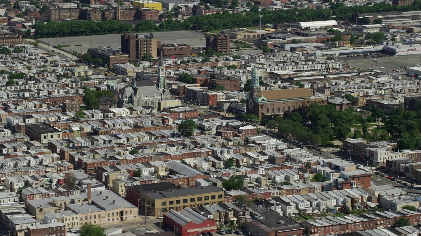 5K stock footage aerial video of churches on Allegheny Ave in an urban neighborhood, North Philadelphia, Pennsylvania Aerial Stock Footage | AX82_029