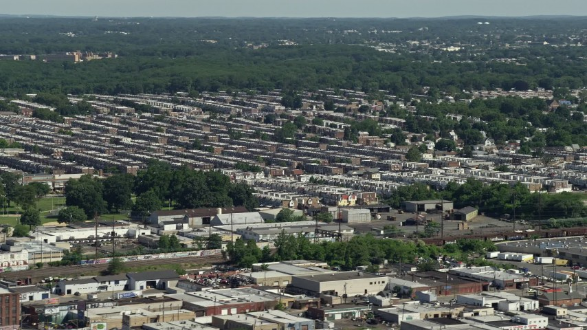 5K stock footage aerial video of row houses in an urban neighborhood, Philadelphia, Pennsylvania Aerial Stock Footage | AX82_035