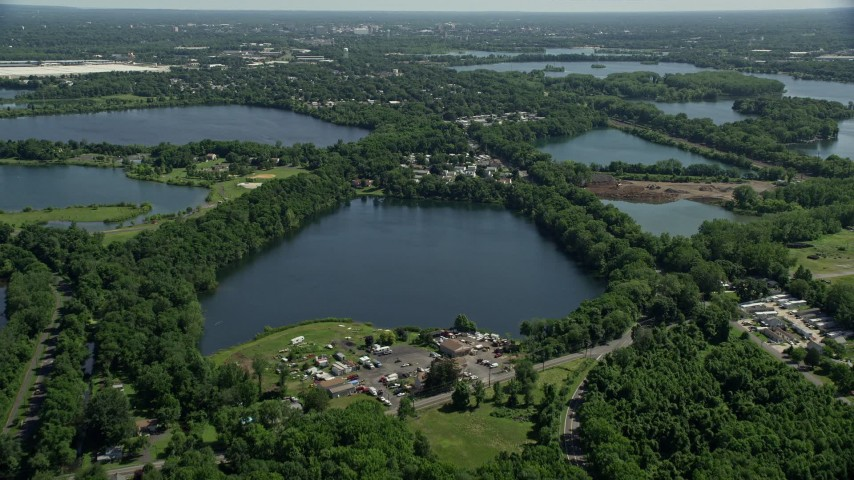 5K stock footage aerial video flying over small lakes and lakeside homes in Morrisville, Pennsylvania Aerial Stock Footage | AX82_055