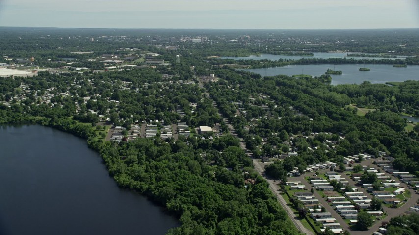 5K stock footage aerial video flying over a mobile home park near a lake in Morrisville, Pennsylvania Aerial Stock Footage | AX82_056